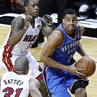 17 June 2012: Oklahoma City Thunder shooting guard Thabo Sefolosha (2) goes toe the basket past Miami Heat point guard Mario Chalmers (15) during the Miami Heat 91-85 victory over the Oklahoma City Thunder, in Game 3 of the 2012 NBA Finals, at the AmericanAirlinesArena, Miami, Florida, USA.