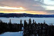 USA, Idaho, Valley County, Donnelly, Tamarack Resort, Sunrise over Long Valley and Payette River Mountains from atop West Mountain
