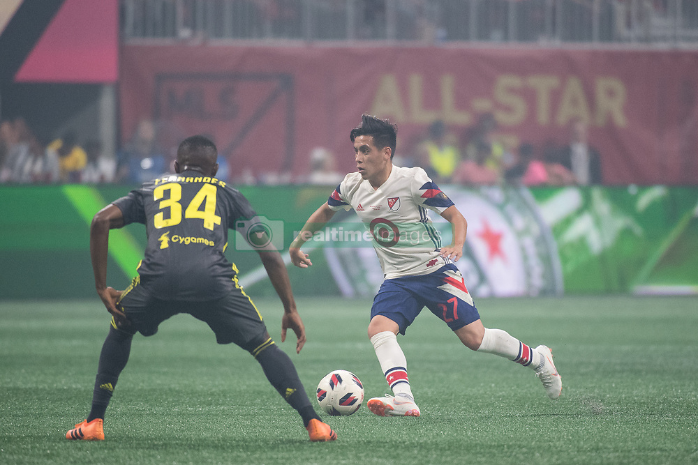 August 1, 2018 - Atlanta, Georgia, United States - MLS All-Star midfielder EZEQUIEL BARCO dribbles the ball against Juventus midfielder LEANDRO FERNANDES, 34 during the 2018 MLS All-Star Game at Mercedes-Benz Stadium in Atlanta, Georgia.   Juventus F.C. defeats  MLS All-Stars defeat  1 to 1  (Credit Image: © Mark Smith via ZUMA Wire)