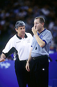 Tall Ferns coach Carl Dickel has a talk with the match referee during the Women's basketball match between New  Zealand and USA at the Sydney Olympic Games, on September 22 2000. Photo: Andrew Cornaga/PHOTOSPORT<br />