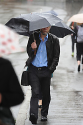 © Licensed to London News Pictures. 27/05/2014<br /> More May Rain today (27.05.2014)<br /> Heavy rain this morning for Commuters at Bromley South station,Bromley,Kent.<br /> Photo credit :Grant Falvey/LNP