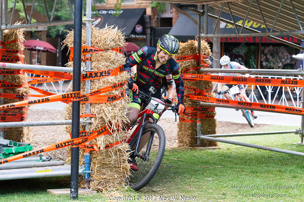 Simon Rogier of France cuts it close under the bridge during the final lap  of the 2017 UCI MTB Eliminator World Cup Round 2 Finals in Columbus, GA, USA on June 4, 2017.