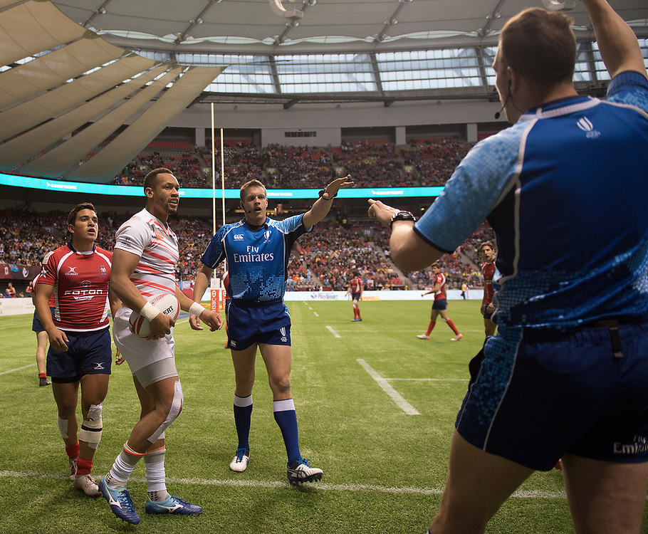 The referee and his assistant debate whether Dan Norton of England took the ball out of play during the pool stages of the Canada Sevens,  Round Six of the World Rugby HSBC Sevens Series in Vancouver, British Columbia, Saturday March 11, 2017. <br /> <br /> Jack Megaw.<br /> <br /> www.jackmegaw.com<br /> <br /> jack@jackmegaw.com<br /> @jackmegawphoto<br /> [US] +1 610.764.3094<br /> [UK] +44 07481 764811
