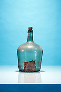 old large glass jar with weathered label