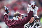 LITTLE ROCK, ARKANSAS - NOVEMBER 23:  Head Coach Dan Mullen of the Mississippi State Bulldogs signals for a touchdown during a game against the Arkansas Razorbacks at War Memorial Stadium on November 23, 2013 in Little Rock, Arkansas.  The Bulldogs defeated the Razorbacks 24-17.  (Photo by Wesley Hitt/Getty Images) *** Local Caption *** Dan Mullen