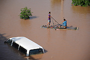 "NANNING, CHINA - SEPTEMBER 21: (CHINA OUT) <br /> <br /> Flood Peak Arrives At Nanning<br /> <br /> Two citizens boat for fish near Lingtie Bridge on September 21, 2014 in Nanning, Guangxi province of China. The highest water level at Yongjiang River in a year comes as Typhoon ""Kalmaegi"" hit Nanning on September 20. The flood peak runs up to 74.83 meters and has been a biggest flood peak since 2008. (<br /> ©Exclusivepix"