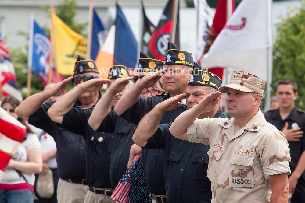 Town of Wallkill, New York - People salute the flag during the Middletown-Town of Wallkill Memorial Day ceremonies at Town of Wallkill Veterans Park on May 25, 2015.