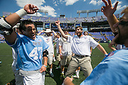 05/25/2014 - Baltimore, Md. - Tufts midfielder Ryan Le, A15, left, celebrates with teammates after Tufts' 12-9 win over Salisbury to win the NCAA Division III Men's Lacrosse National Championship game at M&T Bank Stadium on May 25, 2014. (Kelvin Ma/Tufts University)