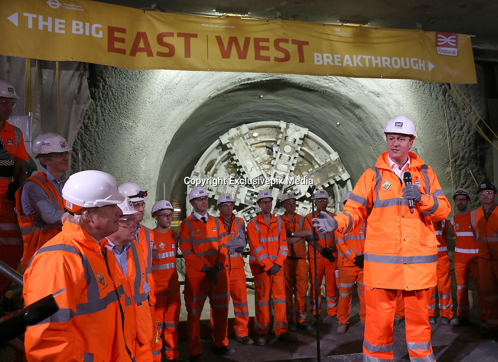 """The Prime Minister and Mayor of London Boris Johnson celebrated the completion of Crossrail's tunnels by going 40 metres below the capital to thank the men and women who are constructing the new £14.8 billion east-west railway.<br />  <br /> Prime Minister David Cameron said: """"Crossrail is an incredible feat of engineering that will help to improve the lives of working people in London and beyond. The project is a vital part of our long term plan to build a more resilient economy by helping businesses to grow, compete and create jobs right along the supply chain.""""<br />  <br /> Crossrail tunnelling began in the summer of 2012 and ended at Farringdon with the break through of tunnelling machine Victoria. Eight 1,000 tonne tunnelling machines have bored 26 miles or 42 km of new 6.2m diameter rail tunnels under London.<br />  <br /> Construction is also advancing on the ten new Crossrail stations and on works above ground west of Paddington and east of Stratford. Over 10,000 people are currently working on Crossrail, including over 450 apprentices.<br />  <br /> With the arrival of Crossrail in 2018, Farringdon will become one of the UK's busiest rail hubs with direct connections to London Underground and upgraded and expanded Thameslink services. This brand new interchange will transform the way passengers travel through London and the South East, providing more capacity and direct connections to three of London's five airports and international rail services at St Pancras. Passengers will also benefit from quicker connections and will be able to travel to Tottenham Court Road in three minutes, Heathrow in just over 30 minutes and Canary Wharf in nine minutes.<br />  <br /> Crossrail will add 10% capacity to London's rail network. It will serve 40 stations, connecting Reading and Heathrow in the west with Shenfield and Abbey Wood in the east. TfL-run Crossrail services through central London will commence in December 2018. An estimated 200 million passengers will trav"""