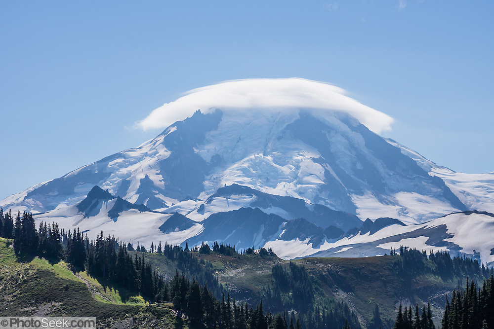 Lenticular (lens-shaped) clouds cap Mount Baker (elevation 10,781 feet) along Skyline Divide trail in Mount Baker Wilderness, Mount Baker-Snoqualmie National Forest, Washington, USA.