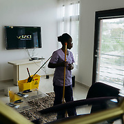 Linda Ayisi cleans an apartment in Accra that rents for $170 a day. Her monthly salary is $32 (150 Ghana cedis). Linda is a single mom. She's not been able to take her 3 year old son to school yet because she can't afford the fees.