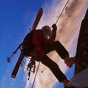 A photo of a skier rappelling off a cliff during small avalanche on Donner Summit, CA..