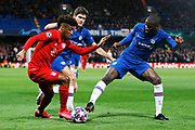 Chelsea defender Antonio Rudiger tackles Bayern Munich forward Kingsley Coman during the Champions League match between Chelsea and Bayern Munich at Stamford Bridge, London, England on 25 February 2020.