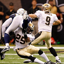 August 27, 2010; New Orleans, LA, USA; New Orleans Saints running back Reggie Bush (25) San Diego Chargers cornerback Nathan Vasher (31) during the second quarter of a preseason game at the Louisiana Superdome. Mandatory Credit: Derick E. Hingle