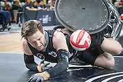 UNITED KINGDOM, London: 2015 World Wheelchair Rugby Challenge. Caption: New Zealand's Dan Buckingham gets knocked to the floor during a tackle as he scores a try. Rick Findler / Story Picture Agency