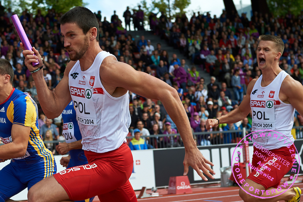 (L) Kamil Masztak and (R) Dariusz Kuc both from Poland compete in men's relay 4 x 100 meters during the Fifth Day of the European Athletics Championships Zurich 2014 at Letzigrund Stadium in Zurich, Switzerland.<br /> <br /> Switzerland, Zurich, August 16, 2014<br /> <br /> Picture also available in RAW (NEF) or TIFF format on special request.<br /> <br /> For editorial use only. Any commercial or promotional use requires permission.<br /> <br /> Photo by &copy; Adam Nurkiewicz / Mediasport