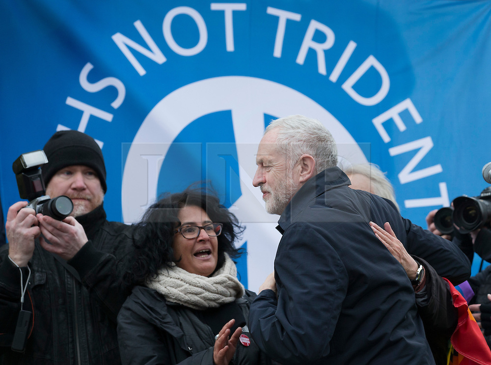© Licensed to London News Pictures. 27/02/2016. London, UK. Labour Party leader Jeremy Corbyn is welcomed on stage to speak at a CND rally in Trafalgar Square. Thousands of protestors calling for the Trident nuclear deterrent to be scrapped have marched from Hyde Park to hear speeches from senior politicians and other campaigners. Photo credit: Peter Macdiarmid/LNP
