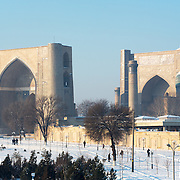 Snow on the Silk Road: people walking by the Bibi Khayam mosque in Samarkand. Feb 5-6, 2014 saw a rare sustained snowy period in Samarkand, Uzbekistan, breaking record lows and resulting in school closures and power outages