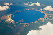Crater Lake, located in the caldera of what was once Oregon's Mount Mazama, is the deepest lake in the United States and the seventh deepest in the world. Its deep blue color results from the clarity of the water. The water is so clear that sunlight travels deep into the lake, losing all but the blue wavelengths in the process.