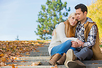 Loving couple sitting on park steps