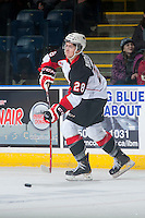 KELOWNA, CANADA - DECEMBER 5: Josh Anderson #28 of Prince George Cougars passes the puck against the Kelowna Rockets on December 5, 2014 at Prospera Place in Kelowna, British Columbia, Canada.  (Photo by Marissa Baecker/Shoot the Breeze)  *** Local Caption *** Josh Anderson;