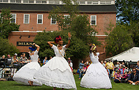 SambaViva, a Brazilian dance group, perform the Baiana dance at Rotary Park during Laconia's Multicultural Festival on Saturday.  (l-r Mariona Lloreta, Randi Henry and Ines Ouedraogo.  (Karen Bobotas/for the Laconia Daily Sun)