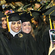 Students pose for photos prior to  President Bill Clinton addressing graduates of UCF's College of Health and Public Affairs and the College of Medicine's Burnett School of Biomedical Sciences at the UCF Arena on Thursday, May 2, 2013 in Orlando, Florida. Clinton was also awarded an honorary degree that  recognizes his service as president and also his service as a humanitarian and international ambassador since he left office. This is his third visit to the UCF campus and he will be the second U.S. president to speak at a UCF graduation ceremony. President Richard M. Nixon addressed graduates in 1973.  (AP Photo/Alex Menendez)