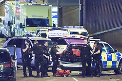 © Licensed to London News Pictures. 23/05/2017. Manchester, UK. Armed police gather on Trinity Way by the Manchester Arena . Police and other emergency services are seen near the Manchester Arena after reports of an explosion. Police have confirmed they are responding to an incident during an Ariana Grande concert at the venue. Photo credit: Joel Goodman/LNP