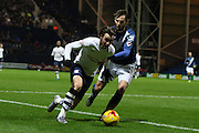 Preston North End Striker Will Keane battles with Birmingham City defender Jonathan Grounds during the Sky Bet Championship match between Preston North End and Birmingham City at Deepdale, Preston, England on 15 December 2015. Photo by Pete Burns.