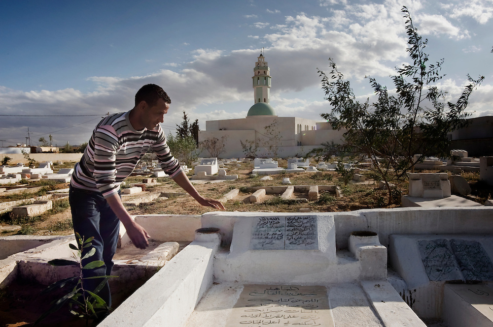 Sidi Bouzid, Tunisia. Feisal Negi visits the tomb of his brother killed by police during the protests that started in Sidi Bouzid after Muhamed Bouazizi's suicide. Sidi Bouzid is a small town with 39,915 inhabitants, located in the middle of Tunisia. It became a point of reference for the Tunisian Revolution as the place where a young street vendor named Mohamed Buazizi set himself on fire in front of the Tunisian Governatorate's  building on December 17th 2010. Buazizi's suicide sparked off the row of the Tunisian revolution that forced Ben Ali to flee the country marking the end of the dictatorship after 23 years.
