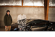 Interview below with artist Laurent La Gamba<br /> <br /> This Supercar trompe l'œil style series is the second one that I do. (After the first one that I named: Moving Superficiality series) and this first photograph (title is : Black Lamborghini Gallardo I) is the first of the series dedicated to Supercars. <br /> <br /> This part of my work that I convey since 2002 and that deal with trompe l'œil (I never liked too much the term camouflage with doesn't echo to the art history enough) is now the next step of my work and deal now with the idea of considering Supercars as full art artefacts.<br /> <br /> As you can see in the making of photographs, I paint  the protective suit myself, because as an Artist this is where I get my interest and passion. It is though a team work that need a lot of preparation and logistics. <br /> <br /> I never paint the full body of the model because, as I said, the goal of the artwork is not to make the model disapear rather than to create a genuine work of art mixing painting, installation and photographical work in which human and artefacts are closely intertwined.<br /> <br /> With this new series, I wanted to be the first Artist doing a trompe l'œil with a Supercar in all the art history and I have chosen this black Lamborghini because it conveys the real image of what a Supercar can be for everyone, mixture of design, art and fascination.<br /> <br /> I use commercial paint and protective suit that I prepare myself, and I different one's with different positions that I use in different Context. This time I used a standing suit. The protective suit is painted in white first, as shown on the photograph, and used exactly like a blank Canvas waiting to be painted. It has to be positionned at the right distance from the camera and from the car. I have chosen on purpose a dark light for the photograph, so the installation would like a real painting.<br /> ©Laurent La Gamba/Exclusivepix Media