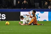 Leeds United player Adam Forshaw (4) and Hull City forward Fraizer Campbell (25) during the EFL Sky Bet Championship match between Hull City and Leeds United at the KCOM Stadium, Kingston upon Hull, England on 30 January 2018. Photo by Ian Lyall.
