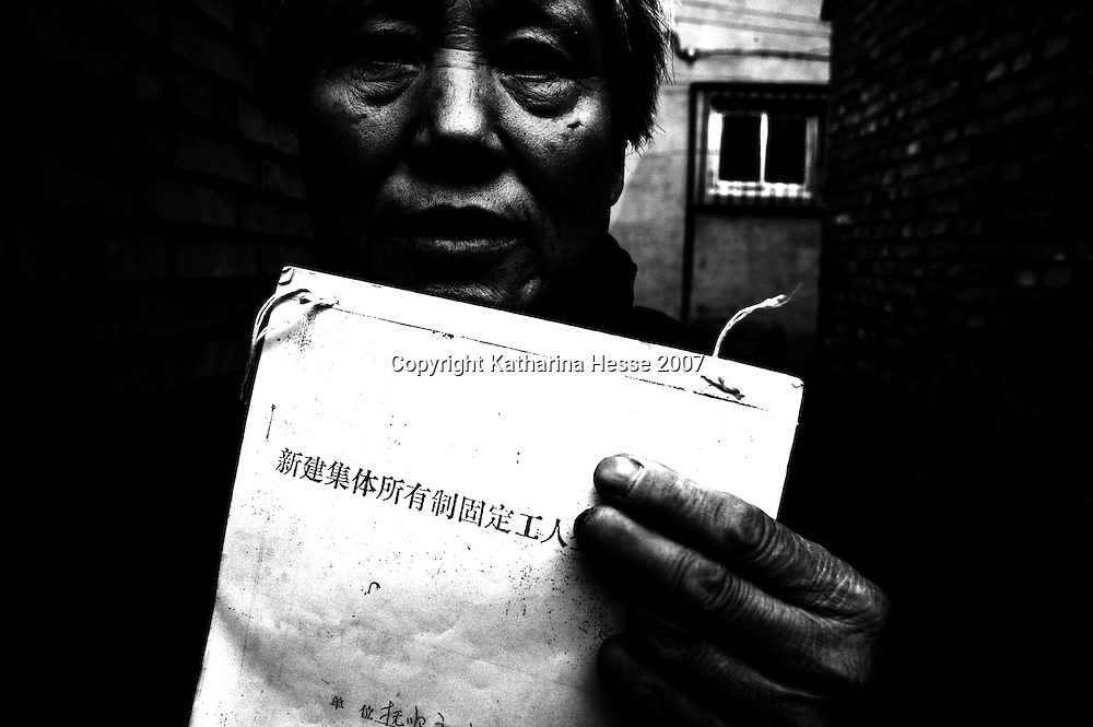 BEIJING, DECEMBER-24:  a woman holds a law suit for a work accident where she lost several members of her hand... In the past decades, hundreds of thousands of Chinese from the provinces have descended upon Beijing in hopes of attracting attention from higher authorities regarding their civil law cases. These cases vary from work accidents, violence against family members, murder, extortion, and the majority of which stem from a corrupt rural legal system...The tradition of petitioning to higher authorities in the Chinese capital reaches back to Imperial times. Outside the city center of Beijing, petitioners' villages sprung up as those seeking justice face long delays in being heard. The petitioners today face tremendous obstacles in having their cases heard; authorities are overworked due to the sheer number of complaints, which are often clumsily presented without aid of a legal adviser. In addition, Provincial as well as undercover police try to stop the petitioners from going to the National Petition offices to file their cases. If caught, they are briefly sent to an unofficial detention centre where they are held and forced to take the train back to the provinces. For many of the petitioners, it has become their life mission to make the regular journey to the capital only to be sent back without ever having been heard...The number of petitioner villages has been reduced significantly as the preparations for the 2008 Olympics progress. Many fear these villages will be gone by the summer of 2008..