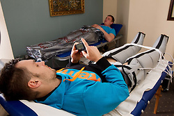 Luka Zvizej in leg bag and Matej Gaber in CO2 treatment bag during visit in the rooms of Slovenia Men Handball team during 5th day of 10th EHF European Handball Championship Serbia 2012, on January 19, 2012 in Hotel Srbija, Vrsac, Serbia.  (Photo By Vid Ponikvar / Sportida.com)