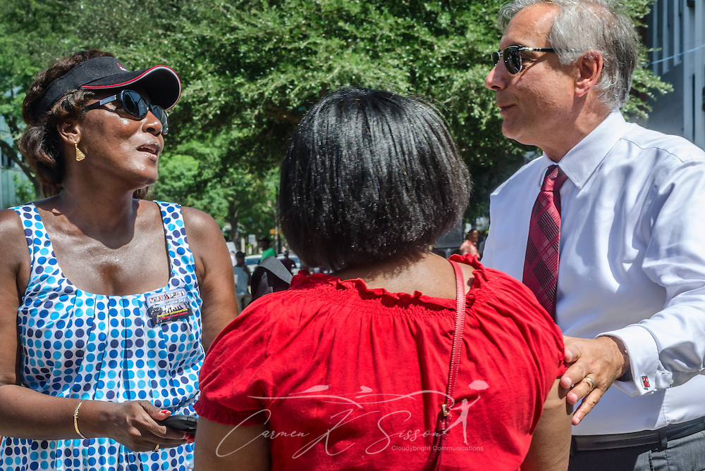 Two women thank University of South Carolina President Harris Pastides for his role in the removal of the Confederate flag, July 10, 2015, at the South Carolina State House in Columbia, S.C. Pastides was among numerous leaders who called for the removal of the flag following the shooting of nine African-Americans at Emanuel African Methodist Episcopal Church in Charleston, June 17, 2015. Alleged shooter Dylann Roof, who published a manifesto on his website supporting white supremacist beliefs, was seen in numerous photographs holding the Confederate flag. The flag flew above the South Carolina State House dome from 1961-2000, then was moved to the grounds. The flag, which is now permanently removed, will be stored at the Confederate Relic Room and Military Museum.(Photo by Carmen K. Sisson/Cloudybright)