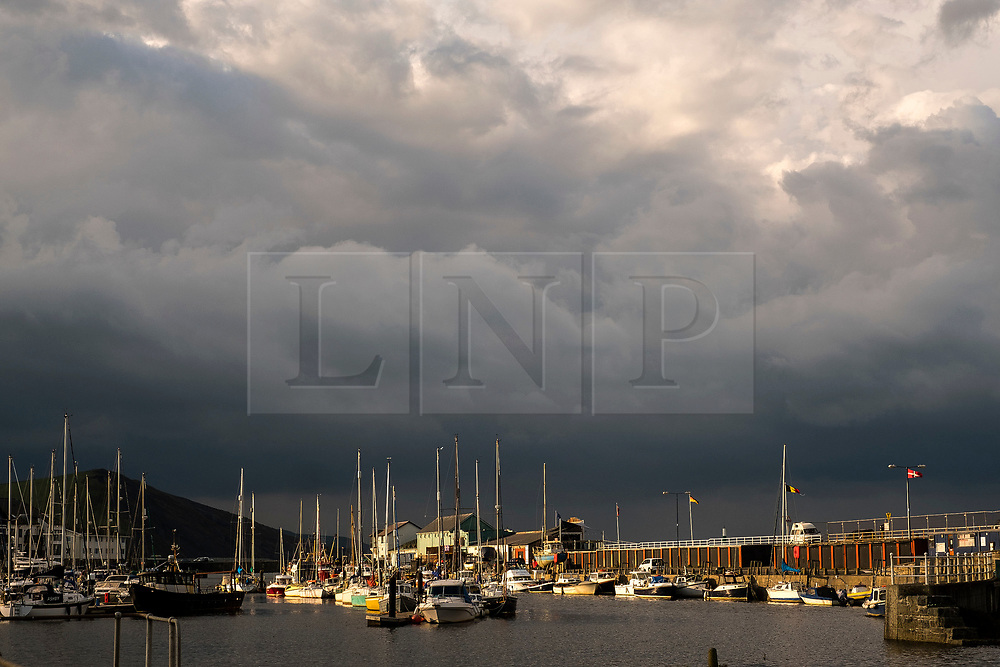 © Licensed to London News Pictures. 11/10/2018. Aberystwyth, UK. Dark storm clouds loom over the harbour and sea at Aberystwyth on the west Wales coast. The weather is set to deteriorate dramatically on Friday and Saturday, with a band of torrential rain bringing the risk of flooding to much of Wales, Scotland  North West  England<br /> Photo credit: Keith Morris/LNP