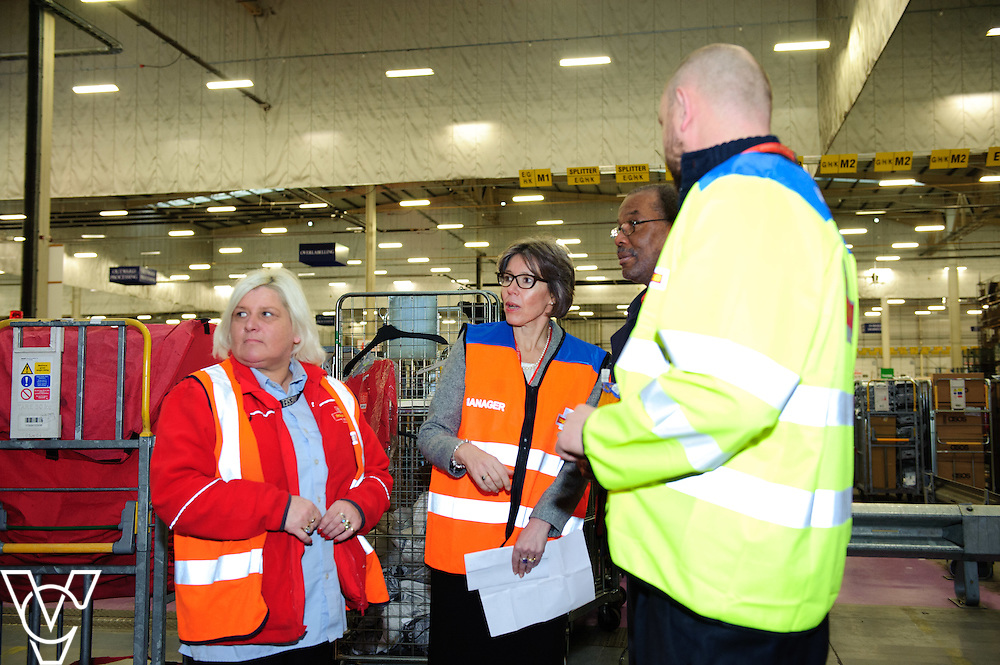 Royal Mail's chief operating officer Sue Whalley, second in from left, talks to, from left, Gail Kitchen, Tony Codner and Dave Sykes<br /> <br /> The team at the Royal Mail's Yorkshire Delivery Centre have won a lucrative new contract with online retail giants ASOS with the Tracked 48 product.<br /> <br /> Date: December 2, 2015