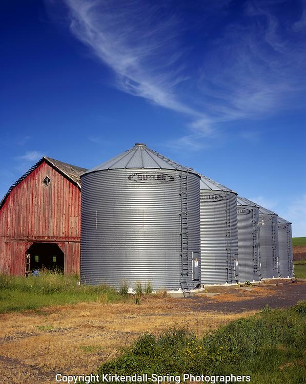 AA07315-01...WASHINGTON - Barn and grain silos in a farm field in the fertile Palouse area of Eastern Washington.