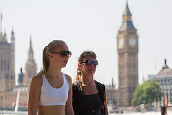 © licensed to London News Pictures. London, UK 17/07/2013. People enjoying the sunshine and hot weather in Westminster, London on Wednesday, 17 July 2013. Photo credit: Tolga Akmen/LNP