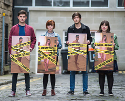 Young campaigners hold giant photos covered in crime scene tape to highlight the introduction from today of the Abusive Behavior and Sexual Harm (Scotland) Act 2016, which now makes it a criminal offence to post so caled 'revenge porn' pictures on social media.<br /> <br /> © Dave Johnston/ EEm