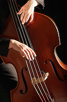 Man Playing Double Bass close up of hands