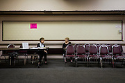 Two women chat as one waits for her take-out lunch order at the Aliquippa Croatian Center in Aliquippa, Pennsylvania, USA on June 5, 2015. All of the steel towns around Pittsburgh had social clubs for Serbians, Croatians, Ukranians, Carpatho-Russians, Italians and countless others. Today most of which are dying off due to lack of interest of the younger generations.