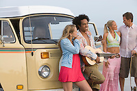 Group of young people with camper van