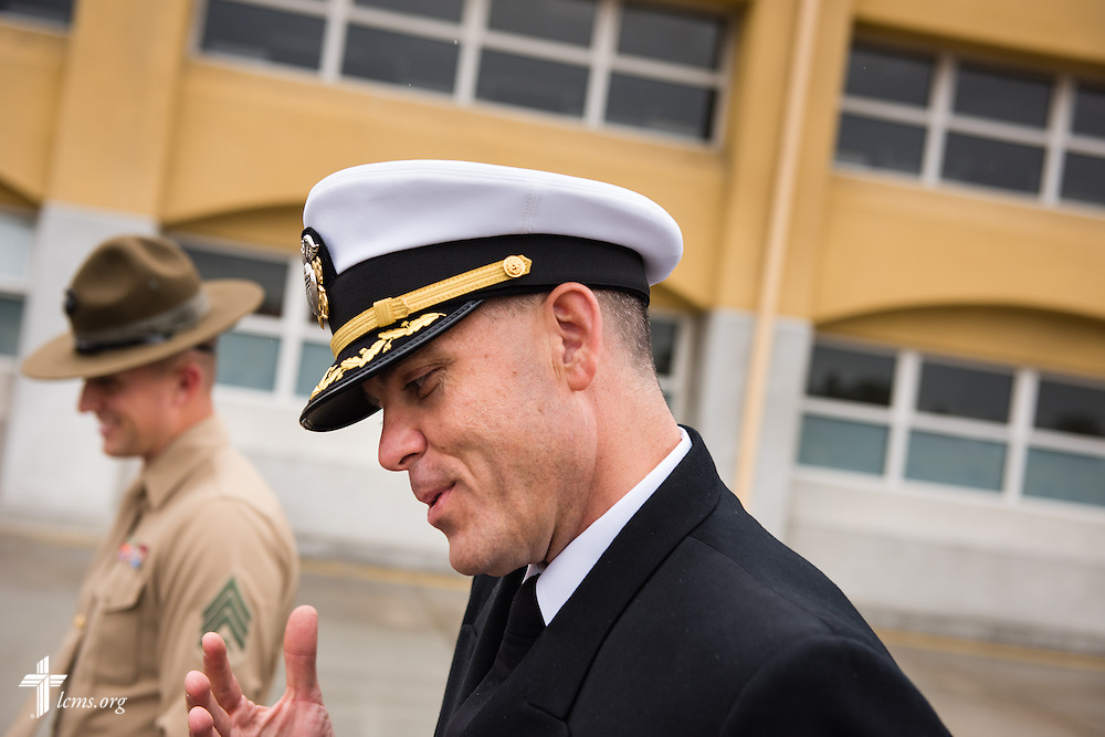 Cmdr. Charles E. Varsogea, chaplain at the Marine Corps Recruit Depot, chats with a drill instructor Friday, Jan. 30, 2015, following a recruit graduation ceremony at the depot in San Diego, Calif. LCMS Communications/Erik M. Lunsford
