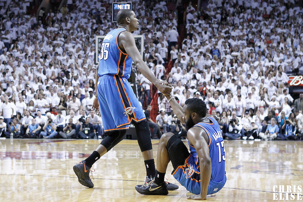 21 June 2012: Oklahoma City Thunder small forward Kevin Durant (35) helps Oklahoma City Thunder guard James Harden (13) to stand up during the second quarter of Game 5 of the 2012 NBA Finals, at the AmericanAirlinesArena, Miami, Florida, USA.