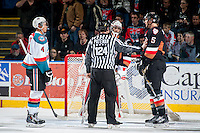 KELOWNA, CANADA - FEBRUARY 28: Keegan Kanzig #5 of Calgary Hitmen gets in the face of Madison Bowey #4 of Kelowna Rockets on February 28, 2015 at Prospera Place in Kelowna, British Columbia, Canada.  (Photo by Marissa Baecker/Shoot the Breeze)  *** Local Caption *** Keegan Kanzig; Madison Bowey;