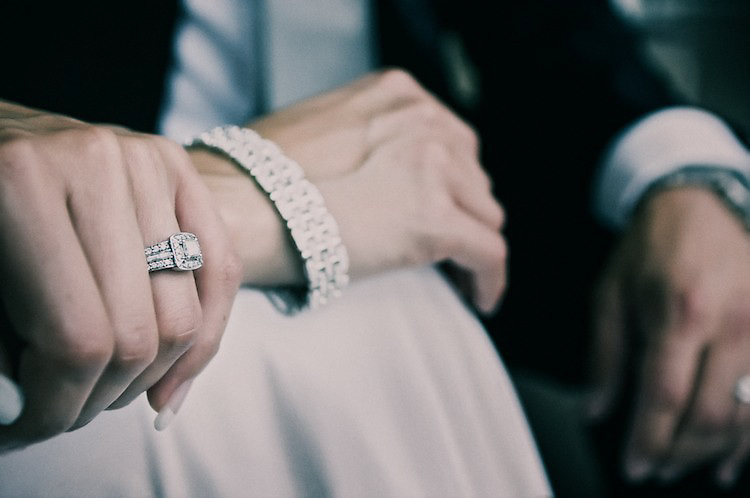 Melinda's gorgeous wedding ring. Alex is seated next to her left.