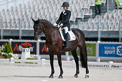 Laurentia Yen-Yi Tan riding Ruben James 2 in the Grade 1a Para-Dressage at the 2014 World Equestrian Games, Caen, Normandy, France..