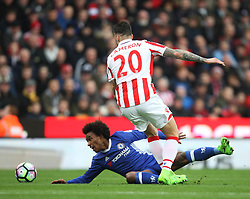 Willian of Chelsea (L) and Geoff Cameron of Stoke City in action - Mandatory by-line: Jack Phillips/JMP - 18/03/2017 - FOOTBALL - Bet365 Stadium - Stoke-on-Trent, England - Stoke City v Chelsea - Premier League
