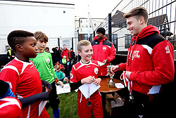 Luke Freeman and Mark Little of Bristol City hand out medals to children for taking part in The BCCT EFL Kids Cup - Mandatory by-line: Robbie Stephenson/JMP - 23/11/2016 - FOOTBALL - South Bristol Sports Centre - Bristol, England - BCCT EFL Kids Cup